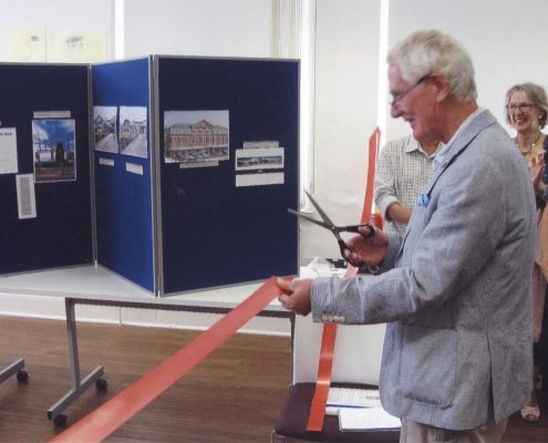 Michael Prichard cutting the tape to open the 25th Anniversary Exhibition 2016